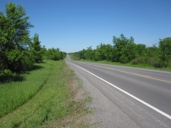 The County road at the entrance to the farm