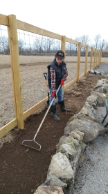 Preparing the raised garden beds in our newly fenced market garden.
